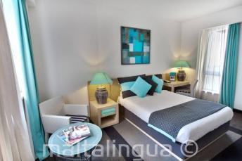 Ložnice v hotelu Juliani, St Julians, Malta