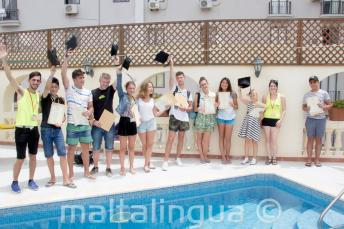 Juniors English language students receiving their course certificates
