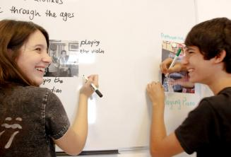 2 students working together on the class board