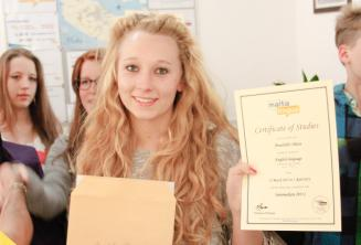 Junior language student with her English course certificate